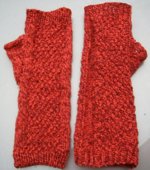 Red fingerless gloves flat