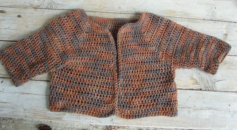 Brown crochet shrug flat
